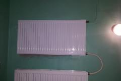Замена радиатора отопления на лестничной клетке